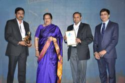 Unni Vasudev (holding award) and Dr. Amit Shekhar (holding plaque) accept the award on behalf of Corbus, LLC